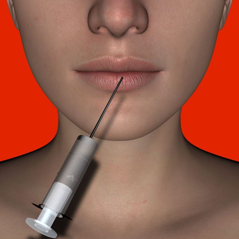 Botox needle injected into women's lips