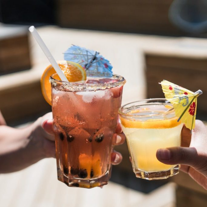 Women holding cocktails